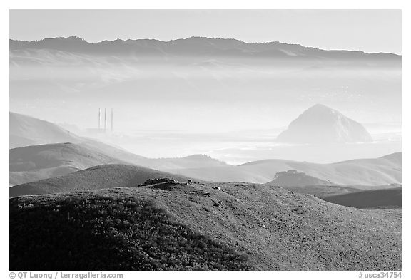 Power plant and Morro Rock seen from hills. Morro Bay, USA (black and white)