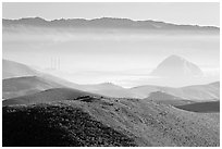 Power plant and Morro Rock seen from hills. Morro Bay, USA ( black and white)