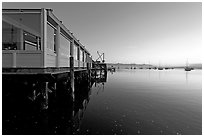 Waterfront restaurant in Morro Bay harbor, sunset. Morro Bay, USA (black and white)