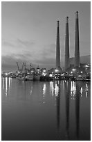 Power station reflected in harbor, dusk. Morro Bay, USA (black and white)