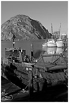 Dredge boat and Morro Rock. Morro Bay, USA (black and white)