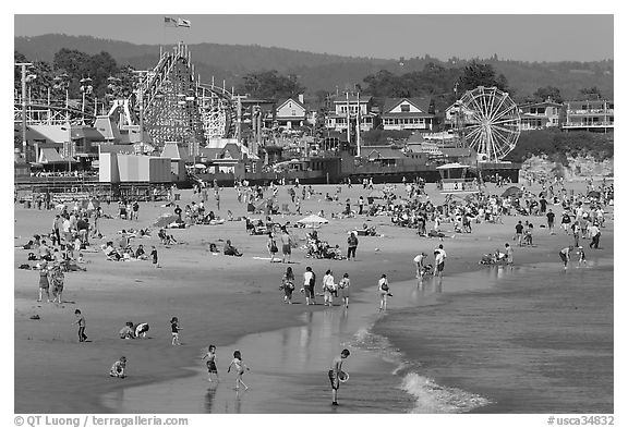 Beach and seaside amusement park on a summer afternoon. Santa Cruz, California, USA (black and white)