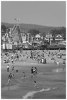 Children, beach, and boardwalk. Santa Cruz, California, USA (black and white)