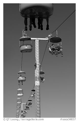 Riding the beach boardwalk aerial gondola. Santa Cruz, California, USA (black and white)
