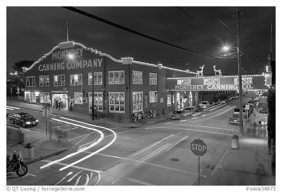 Monterey Canning Company building at night. Monterey, California, USA (black and white)