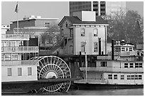 Riverboats Delta King and Spirit of Sacramento, modern and old buildings. Sacramento, California, USA (black and white)