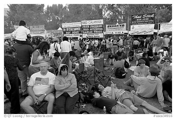 Crowd sitting on the grass in Guadalupe River Park, Independence Day. San Jose, California, USA (black and white)