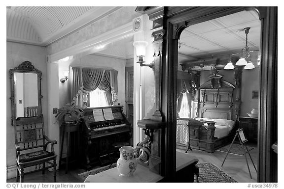 Mirror and last bedroom of Sarah Winchester. Winchester Mystery House, San Jose, California, USA (black and white)