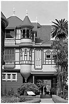 Mansion wing with door opening to a one-story drop. Winchester Mystery House, San Jose, California, USA (black and white)