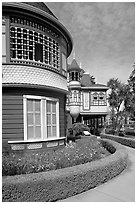 Mansion wing with door to nowhere in the background. Winchester Mystery House, San Jose, California, USA (black and white)