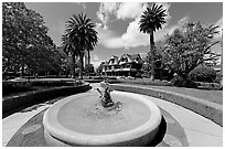 Wide view of fountain, gardens,  and mansion. Winchester Mystery House, San Jose, California, USA ( black and white)