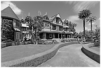 Gardens and facade. Winchester Mystery House, San Jose, California, USA (black and white)