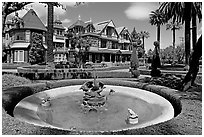 Basin, gardens and facade. Winchester Mystery House, San Jose, California, USA (black and white)
