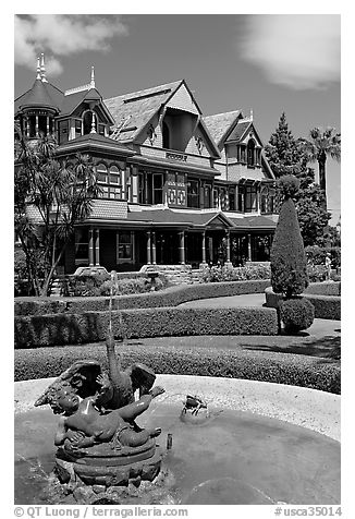 Fountain and facade. Winchester Mystery House, San Jose, California, USA (black and white)