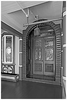 Main entrance doors, always locked. Winchester Mystery House, San Jose, California, USA ( black and white)