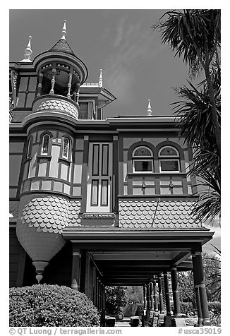 Door to nowhere, opening to a one-story drop. Winchester Mystery House, San Jose, California, USA (black and white)