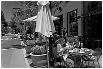 Street and outdoor restaurant tables. Santana Row, San Jose, California, USA (black and white)