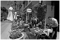 Lunch at streetside restaurant tables. Santana Row, San Jose, California, USA (black and white)