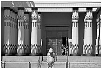 Facade of the  Rosicrucian  Egyptian Museum  with tourists entering. San Jose, California, USA ( black and white)