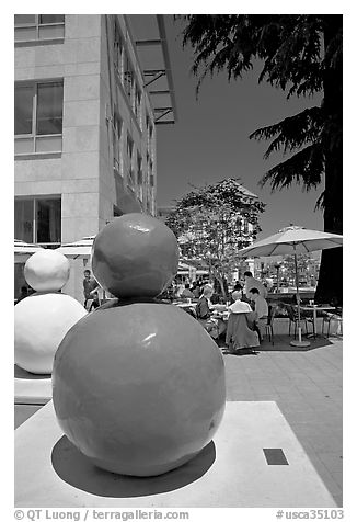Sculpture  and outdoor restaurant terrace, Castro Street, Mountain View. California, USA (black and white)
