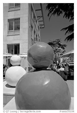 Sculptures and outdoor lunch, Castro Street, Mountain View. California, USA (black and white)