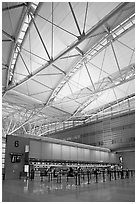 Check-in booth, SFO airport, designed by Craig Hartman. California, USA (black and white)