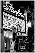 Woman changing movie title, Stanford Theatre. Palo Alto,  California, USA ( black and white)