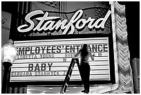 Neon signs and movie title being rearranged, Stanford Theater. Palo Alto,  California, USA (black and white)