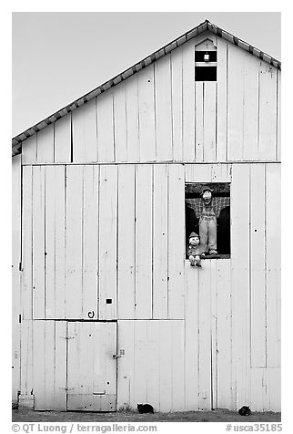 Figures in barn window and cats, Rancho San Antonio Preserve, Los Altos. California, USA (black and white)