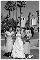 Bride and bridesmaids in front of mission, Santa Clara University. Santa Clara,  California, USA (black and white)