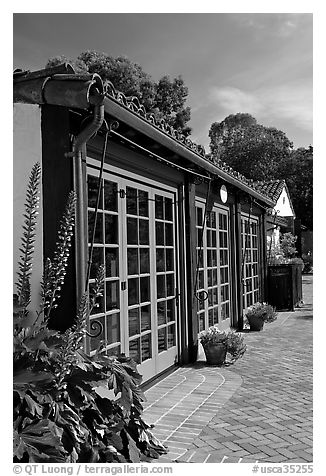 European-style glass doors and brick pavement, Allied Arts Guild. Menlo Park,  California, USA (black and white)