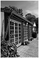 European-style glass doors and brick pavement, Allied Arts Guild. Menlo Park,  California, USA ( black and white)