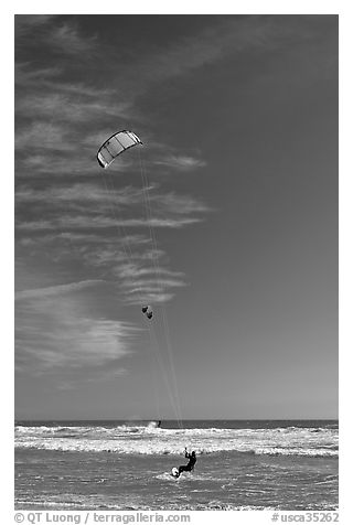 Kite surfers, waves, and ocean, Waddell Creek Beach. California, USA (black and white)