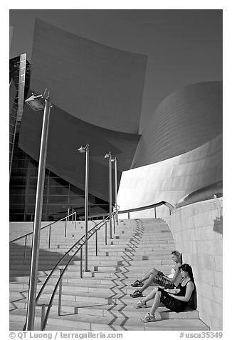 Women sunning on the steps of the entrance of the Walt Disney Concert Hall. Los Angeles, California, USA (black and white)
