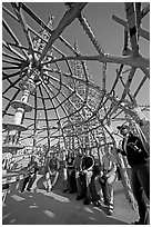 Tour guide and group in the Gazebo of the Watts Towers. Watts, Los Angeles, California, USA ( black and white)