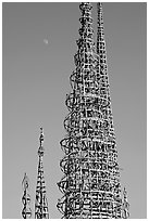 Simon Rodia Watts Towers and moon, late afternoon. Watts, Los Angeles, California, USA (black and white)