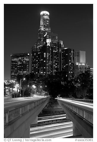 Bridge above Harbor Freeway and US Bank building at night. Los Angeles, California, USA (black and white)