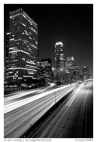 Traffic on Harbor Freeway and skyline at night. Los Angeles, California, USA (black and white)