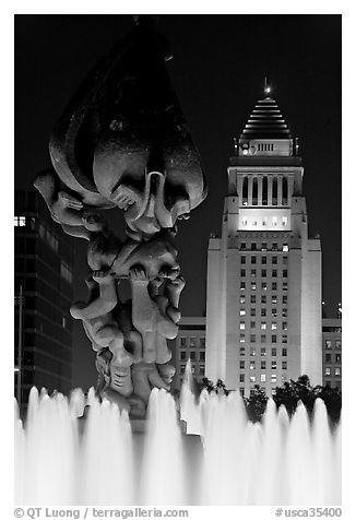 Peace on Earth sculpture, fountain, and City Hall at night. Los Angeles, California, USA (black and white)