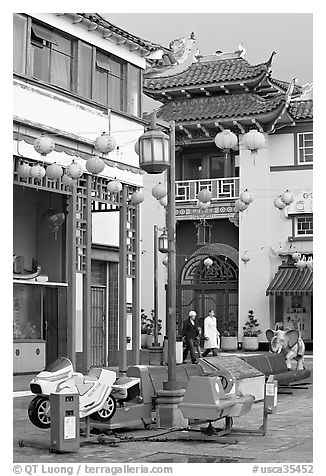 Rides and buildings in Chinese style, Chinatown. Los Angeles, California, USA (black and white)