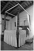 Bedroom in the Avila Adobe, Los Angeles  oldest building (1818). Los Angeles, California, USA ( black and white)