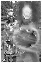 Aztec dancers in motion,  El Pueblo historic district. Los Angeles, California, USA ( black and white)