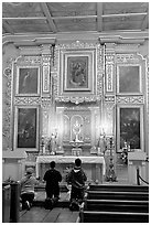Prayer at altar in Mission Chapel. Los Angeles, California, USA ( black and white)