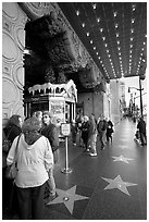 Stars of the Walk of fame in front of the  El Capitan Theatre. Hollywood, Los Angeles, California, USA ( black and white)