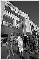 People dressed as movie characters in front of the Kodak Theatre. Hollywood, Los Angeles, California, USA ( black and white)