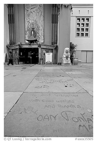 Handprints and footprints of actors and actresses in cement, Grauman theater forecourt. Hollywood, Los Angeles, California, USA (black and white)