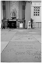 Handprints and footprints of actors and actresses in cement, Grauman theater forecourt. Hollywood, Los Angeles, California, USA ( black and white)