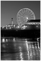 Ferris Wheel in motion at nightfall. Santa Monica, Los Angeles, California, USA ( black and white)