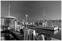 Fishing boat and harbor gas station. Marina Del Rey, Los Angeles, California, USA ( black and white)
