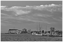 Yachts and industrial installations, port of Redwood, sunset. Redwood City,  California, USA (black and white)
